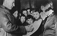 0171503 © Granger - Historical Picture ArchiveSOVIET UNION PROPAGANDA.   Soldier explaining a model tank to children, c1937. Full credit: ullstein - Archiv Gerstenberg / Granger, NYC -- All rights reserved.