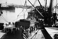 0173230 © Granger - Historical Picture ArchiveLIBYA: GERMAN SOLDIERS, 1941.   German soldiers unloading supplies and equipment in the harbor of Tripoli, Libya, during World War II. Photograph, April 1941.