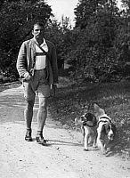 0175336 © Granger - Historical Picture ArchiveCARL ZUCKMAYER (1896-1977).  German writer. Photographed with his dogs in 1932. Full credit: Alfred Eisenstaedt - ullstein bild / Granger, NYC -- All rights reserved.