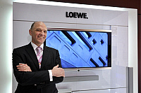 0177997 © Granger - Historical Picture ArchiveFRIEDER C. LOEHRER.   Loehrer, Frieder C. - CEO of the Loewe AG, Germany - standing in front of a flatscreen TV - 25.03.2009. Full credit: ullstein bild / Granger, NYC -- All right