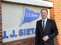 0179237 © Granger - Historical Picture ArchiveFUCHS.   Fuchs, Ruediger - Manager, Germany - designated chairman of J.J. Sietas KG shipyard standing in front of the company nameplate in Hamburg, Germany - 12.02.2009. Full credit: ullstein bild / Granger, NYC -- All rights reserved.