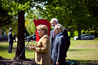 0179265 © Granger - Historical Picture ArchiveFIELMANN.   Fielmann, Guenther - Entrepreneur, Germany - Chairman and Owner Fielmann plc - plants with Angela Merkel and Peter Harry Carstensen (background) a Fielmann-tree - 06.07.2009. Full credit: ullstein bild / Granger, NYC -- All righ