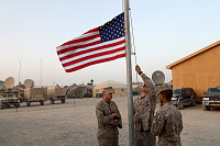 0184280 © Granger - Historical Picture ArchiveAFGHANISTAN: U.S. SOLDIERS.   U.S. Marines lowering the American flag at sundown, at Camp Bastion in Afghanistan. Photograph, 2009. Full credit: Knut Müller - ullstein bild / Granger, NYC -- All Rights Reserved.