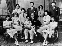 0184347 © Granger - Historical Picture ArchiveKENNEDY FAMILY, 1938.   Portrait of the Kennedy family. Left to right, seated: Eunice, Jean, Joseph, Edward (on lap of his father), Patricia, and Kathleen. Standing: Rosemary, Robert, John, Rose, and Joseph, Jr. Photographed in Bronxville, New York, 1938.