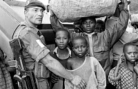 0184884 © Granger - Historical Picture ArchiveRWANDAN REFUGEES, 1994.   French Foreign Legion soldier with refugees from Rwanda at the Congo border. Photograph, 1994. Full credit: Giribas - ullstein bild / Granger, NYC -- All Rights Reserved.