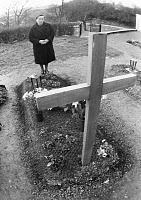 0185973 © Granger - Historical Picture ArchiveGERMANY: CEMETERY, 1976.   A woman standing next to a new grave in a German cemetery. Photograph, 1976. Full credit: Werner OTTO - ullstein bild / Granger, NYC -- All rights reserv