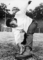 0186196 © Granger - Historical Picture ArchiveMUHAMMAD ALI (1942-2016).   Né Cassius Clay. American heavyweight boxer. Photographed stretching in the Frankfurt City Forest in Germany, 1966. Full credit: Horstmuller - ullstein bild / Granger, NYC -- All rights reserved.
