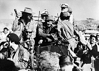0192013 © Granger - Historical Picture ArchiveFIDEL CASTRO (1926-2016).  Cuban revolutionary leader. The revolutionists, led by Castro (center) and cheered on by the population, invade Havana. Left from Casto (with gun) is Camilo Cienfuegos. Photograph, 8 January 1959. Full Credit: Ullstein Bild / Granger, NYC. All Rights Reserved.