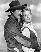 0194232 © Granger - Historical Picture ArchiveERROL FLYNN.   Flynn, Errol *20.06.1909-14.10.1959+ Actor, Australia with Patricia Wymore in the movie Rocky Mountain - 1950 01041647.
