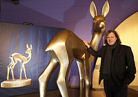 0195994 © Granger - Historical Picture ArchiveFRIEDHELM SCHATZ.   Schatz, Friedhelm - Chairman of Filmpark Babelsberg, Germany - standing next to a giant Bambi trophy in the Metropolis hall at Filmpark Babelsberg in Potsdam, Germany - 11.03.2009 .