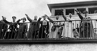 0197253 © Granger - Historical Picture ArchiveOLYMPIC GAMES, 1936.   German Chancellor Adolf Hitler and leading Nazi politicians, including Wilhelm Frick and Joseph Goebbels, saluting at the Olympics Games in Berlin, Germany. Photograph, 1936.