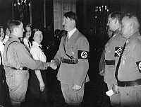 0197510 © Granger - Historical Picture ArchiveGERMAN REICH.   German Reich: Adolf Hitler giving a reception in the Reichskanzlei for the winners in the so called Reichsberufswettkampf (Reichs Profession Competition); in the background, from left: the leader of the Deutsche Arbeitsfront (DAF, German Labour Front) Robert Ley, Reichsjugendfuehrer Baldur v. Schirach, and Joseph Goebbels - Published in B.Z.