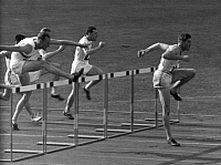 0201181 © Granger - Historical Picture ArchiveOLYMPICS: BERLIN, 1936.   The men's hurdle event at the Olympic Summer Games in Berlin. Participants include Volmari Iso-hollo (Finland) and Forest Towns (USA). Photographed by Lothar Ruebelt, 1936.