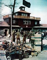 0216484 © Granger - Historical Picture ArchiveBUCHENWALD LIBERATED, 1945.   Soldiers of the U.S. Third Army at the entrance to the liberated Buchenwald concentration camp in Germany. Photograph, 18 April 1945. Full credit: LEONE - ullstein bild / Granger, NYC -- All rights reserved.
