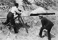 0217519 © Granger - Historical Picture ArchiveLABOR.   shooting of a film scene, shooting in a sandpit, using a model train and false perspective, date unknown, around 1921.