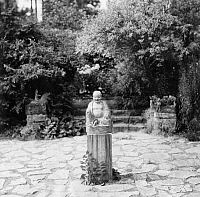 0218116 © Granger - Historical Picture ArchiveCULTURE.   German Empire Free State Prussia - Brandenburg Provinz (Province) - Berlin Garden of the Cultural Historian Eduard Fuchs. Little statue of a Buddha. - Photographer: Emil Leitner - Published by: 'Dame' 15/1928 Vintage property of ullstein bild.