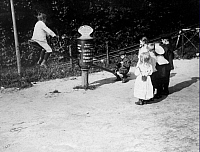 0218270 © Granger - Historical Picture ArchiveCULTURE.   Germany, Kingdom Prussia, Brandenburg Province - Berlin: Children plays on a seesaw at a funfair - Published by: 'Berliner Illustrirte Zeitung' 06 / 1907 Vintage property of ullstein bild.