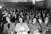 0218582 © Granger - Historical Picture ArchiveDAILY LIFE.   Germany Hamburg Altstadt - Spactators are laughing about a play at the cinema Kammer-Lichtspiele. - Fifties.