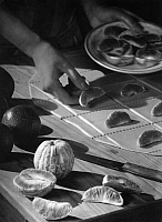 0218666 © Granger - Historical Picture ArchiveDAILY LIFE.   cuisine: cooking and baking with oranges, filling dumplings with slices of orange, date unknown, around 1930, photo by Fotografisches Atelier Ullstein.