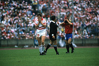 0218949 © Granger - Historical Picture ArchiveSOCCER.   UEFA European Football Championship 1988, final_tournament in Germany, Group 1 in Hanover, Denmark vs. Spain 2:3, scene of the match f.l.t.r. Flemming Povlsen (DEN), referee Albert R. Thomas (NED), José Maria Bakero Escudero (ESP) , June 11, 1988.
