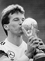 0218994 © Granger - Historical Picture ArchiveSOCCER.   1990 FIFA World Cup in Italy Lothar Matthaeus, captain of the German national team, kissing the World Cup trophy after the victory in the final against Argentina - - 08.07.1990.