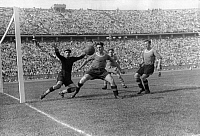 0219152 © Granger - Historical Picture ArchiveSOCCER.   German war championship final in Berlin (olympic stadium) in the presence of 95.000 spectators: Rapid Wien - Schalke 04 (4:3) - Goal keeper of Vienna, Rodolf Raftl, jumping to the wrong corner expectating a cross ball. It marks the 3:0 score for Schalke. 22.June 1941 Fussball Finale Tor.