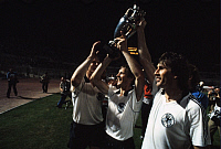 0219420 © Granger - Historical Picture ArchiveSOCCER.   UEFA European Football Championship 1980 in Italy, final in Rome: Belgium - Fed. Rep. of Germany 1:2, European Champion West Germany, Manfred, Karl-Heinz Foerster, Horst Hrubesch (f.r.t.l.) with the cup, June 22, 1980.