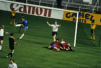 0220043 © Granger - Historical Picture ArchiveSOCCER.   UEFA European Football Championship 1984, Final_tournament in France, Group phase, Group 2 in Paris: Fed. Rep. of Germany vs. Spain 0:1, goal cheer Spain, scorer Antonio Maceda Frances (ESP, c., occluded) and two Spanish players rejoice, German goalkeeper Harald 'Toni' Schumacher (l.) and defender Karl-Heinz Foerster (r.) on the goal line, refer