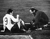 0220628 © Granger - Historical Picture ArchiveSOCCER.   UEFA European Football Championship 1968, Preliminary round, Group 5, match in Budapest: Hungary vs. German Democratic Republic (GDR, East Germany) 3:1 - medical attendant Schenk cares about Henning Frenzel (GDR, left), September 27, 1967.