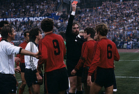 0220871 © Granger - Historical Picture ArchiveSOCCER.   UEFA European Football Championship 1984, Preliminary round, Group 6, match in Saarbruecken: Fed. Rep. of Germany vs. Albania 2:1, referee Anders Mattson (FIN) sends Albanian player Genc Tomori off, November 20, 1983.
