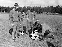 0220958 © Granger - Historical Picture ArchiveSOCCER.   1974 FIFA World Cup in Germany Charity action by members of the East German national team they were donating a football with autographs of them for a school in Ellerbek. From the left: Ruediger Schnuphase, Lothar Kurbjuweit, Joachim Fritsche - - 19.06.1974.