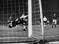 0221101 © Granger - Historical Picture ArchiveSOCCER.   UEFA European Football Championship 1968, Preliminary round, Group 5, match in Budapest: Hungary vs. German Democratic Republic (GDR, East Germany) 3:1 - Henning Frenzel (GDR, right) scores against goalkeeper Gyula Tamas, September 27, 1967.