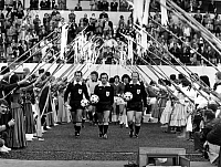 0221202 © Granger - Historical Picture ArchiveSOCCER.   1978 FIFA World Cup in Argentina First round, Group 2 in Cordoba: Germany 6 - 0 Mexico - the two teams are entering the pitch past a folklore guard of honour dressed up in traditional custume front, middle: referee Bouzo from Syria - - 06.06.1978.