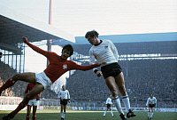 0221310 © Granger - Historical Picture ArchiveSOCCER.   UEFA European Football Championship 1976, preliminary round, group 8 in Dortmund: Fed. Rep. of Germany vs. Malta 8:0, duel between an unknown Maltese player and Josef 'Jupp' Heynckes (FRG, right), February 28, 1976.
