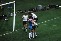 0221578 © Granger - Historical Picture ArchiveSOCCER.   UEFA European Football Championship 1984, Final_tournament in France, Group phase, Group 2 in Paris: Fed. Rep. of Germany vs. Spain 0:1, scene of the match, after German goalkeeper Harald 'Toni' Schumacher has saved a penalty Andreas Brehme (on top), Bernd Foerster and Uli Stielike (l.) rejoice with him, June 20, 1984.