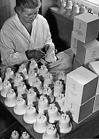 0222549 © Granger - Historical Picture ArchiveSPORTS.   Olympic Games Berlin 1936: employee packing porcelain replicas of the Olympic bell manufactured by the Staatliche Porzellan-Manufaktur Berlin - Photographer: Heinz Fremke - Published by: 'Berliner Morgenpost' 22.12.1935 Vintage property of ullstein bild.
