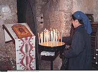 0223780 © Granger - Historical Picture ArchiveRELIGION.   Israel, Jersualem, Via Dolorosa. Procession on Good Friday. Catholic nun donating a candle. 02.04.1999.