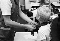 0224404 © Granger - Historical Picture ArchiveEDUCATION.   Germany - Berlin - Ost-Berlin East Berlin: teacher tieing around a boy the pioneer neckerchief - 01.01.1986.