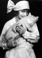0225296 © Granger - Historical Picture ArchiveCUSTOM.   New Year's Eve. Woman and a lucky pig. Picture by von Bucovich 1929.