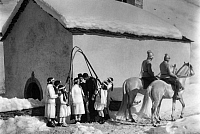 0226794 © Granger - Historical Picture ArchivePEOPLE.   winter in the mountains: marriage ceremony in front of a chapell, bridesmaids holding up ski in form of a baldachin - 1928 Vintage property of ullstein bild.