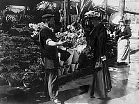 0227542 © Granger - Historical Picture ArchivePEOPLE.   male florist selling flowering azalea to a female customer, date unknown, probably around 1900, published in Praktische Berlinerin 13/1906.