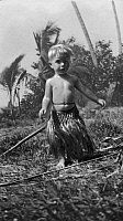 0227604 © Granger - Historical Picture ArchivePEOPLE.   Tambs, Erling - writer and sailor, Norway *25.05.1888-1967+ Circumnavigation of the globe (series) - son Tony in a traditional costume on Tahiti - Photographer: Erling Tambs - Published by: 'Berliner Illustrirte Zeitung' 12/1932 Vintage property of ullstein bild.