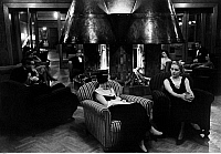 0227657 © Granger - Historical Picture ArchivePEOPLE.   Series At the skihotel. Hotel Pricipi di Piemonte in Sestrières. People sitting by the fireside after diner. Picture taken 1934 by Alfred Eisenstaedt..