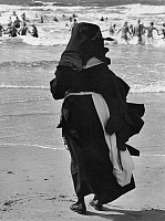 0228320 © Granger - Historical Picture ArchivePEOPLE.   Germany - North Frisia - Borkum: catholic nuns at the beach, watching the bathing orphan children - Photographer: Gert Kreutschmann - - undated Vintage property of ullstein bild.