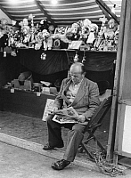 0228374 © Granger - Historical Picture ArchivePEOPLE.   Germany: man reading a newspaper at a funfair - Photographer: Gert Kreutschmann - 1958 Vintage property of ullstein bild.