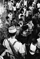 0228848 © Granger - Historical Picture ArchivePEOPLE.   Philippines, Manila: children with soldier. - November 1970.
