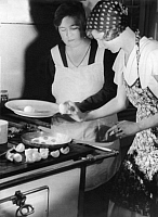 0229011 © Granger - Historical Picture ArchivePEOPLE.   Series: 'Carp roulade': woman preparing fried eggs - Photographer: Yva - Published in Uhu 12/1932 Vintage property of ullstein bild.