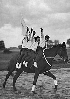 0229328 © Granger - Historical Picture ArchivePEOPLE.   German Empire: Children vaulting: children presenting vaulting exercise at the equestrian festival in Berlin Ruhleben - Photographer: A. Menzendorf - Published by: 'Zeitbild' 41/1931 Vintage property of ullstein bild.