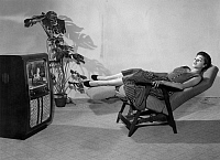 0229774 © Granger - Historical Picture ArchivePEOPLE.   Woman watching tv in the chair Himolla Cumulus during the tv fair Fernsehschau Muenchen (14.11.-21.11.1954). - November 1954.