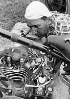0229890 © Granger - Historical Picture ArchivePEOPLE.   The motorcyclist Haselbeck from Nuremberg looking at the motor of his motorbike - Photographer: Heinz Fremke - Published by: 'Das 12 Uhr Blatt' 20.05.1938 Vintage property of ullstein bild.